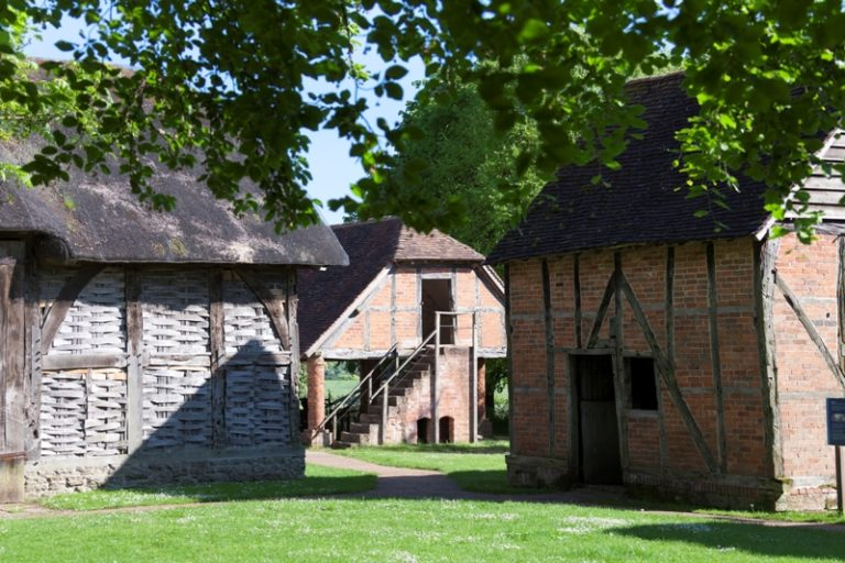 Avoncroft Museum's historic agricultural buildings - Threshing barn, Granary and farm stable, in bright sunshine
